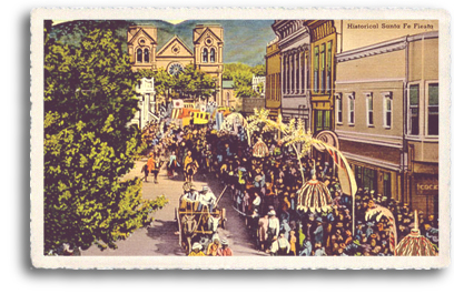 This colorful vintage postcard depicts the Historical/Hysterical Parade on the streets of downtown Santa Fe, New Mexico. As part of the annual Fiesta de Santa Fe (Santa Fe Fiesta) in early September, the event takes place at the site of the historic Santa Fe Plaza.